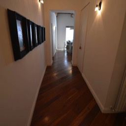 Casa Monte: Looking down the hallway, the parquet floor and row of art work aside