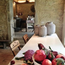 Poggiodoro: The dining area, kitchen in the background